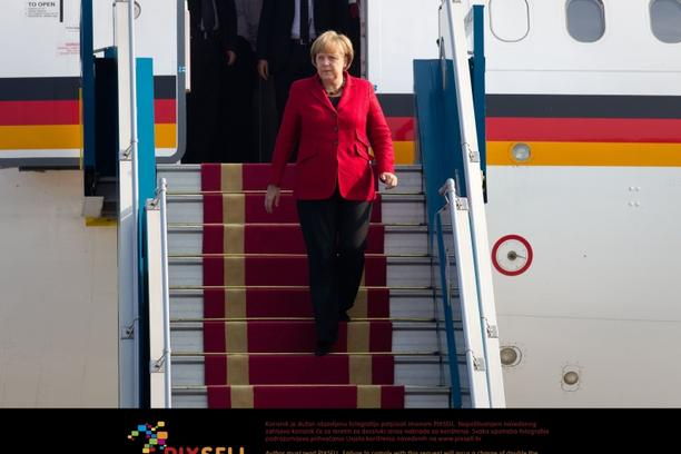 'Chancellor Angela Merkel leaves the governmental aircraft at the airport  Hanoi Noibai in Hanoi, Vietnam, 11 October 2011. Among meeting Prime Minister Tan Dzung Merkel intends to visit economic comp
