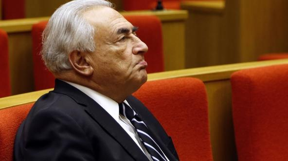 'Former International Monetary Fund (IMF) chief Dominique Strauss-Kahn reacts as he attends a French Senate commission inquiry on the role of banks in tax evasion in Paris in this June 26, 2013 file p