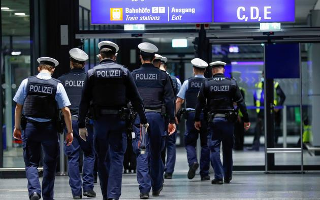 Federal police officers check flight passengers arriving from Britain at Frankfurt Airport