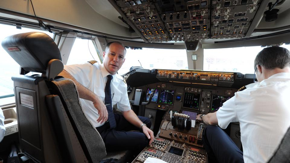 Captain Sergio De Witt (L) and his co-pilot Daniel Schaefer (R) sit in the cockpit of a Boeing 747-8 Intercontinental jet airliner at the airport in Munich, Germany, 21 November 2012. Airline Lufthansa acquired the new version of the jez airliner in May 2