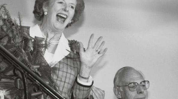 'Britain's Prime Minister Margaret Thatcher gives a jubilant wave from the stairs inside her Conservative party headquarters in London early in this June 12, 1987 file photo, after sweeping back to p