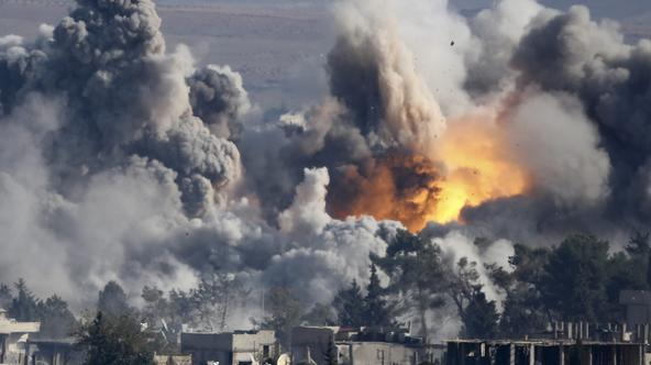Smoke rises over Syrian town of Kobani after an airstrike, as seen from the Mursitpinar border crossing on the Turkish-Syrian border in the southeastern town of Suruc in Sanliurfa province, October 18, 2014. A U.S.-led military coalition has been bombing