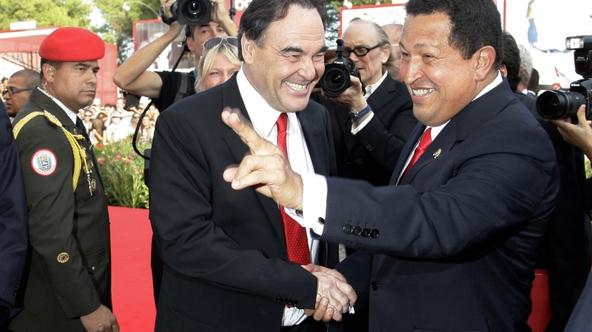 'U.S. film director Oliver Stone (L) and Venezuela\'s President Hugo Chavez pose for photographers during a red carpet at the 66th Venice Film Festival September 7, 2009. REUTERS/Tony Gentile (ITALY E