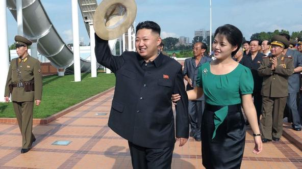 'North Korean leader Kim Jong-Un and his wife Ri Sol-Ju attend the opening ceremony of the Rungna People's Pleasure Ground on Rungna Islet along the Taedong River in Pyongyang in this July 25, 2012 p