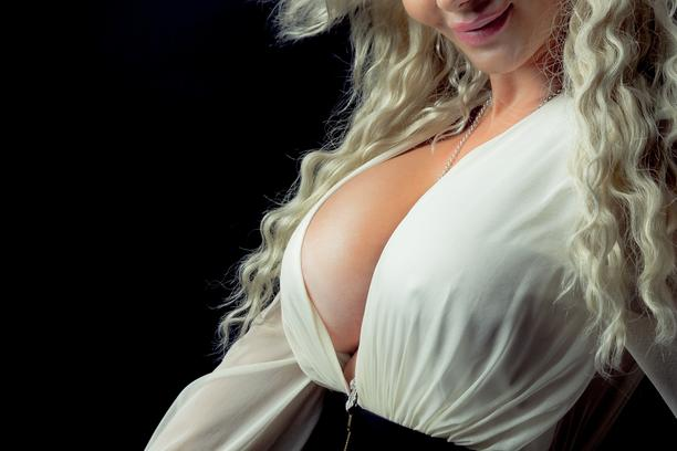 Middle age woman with silicone breasts