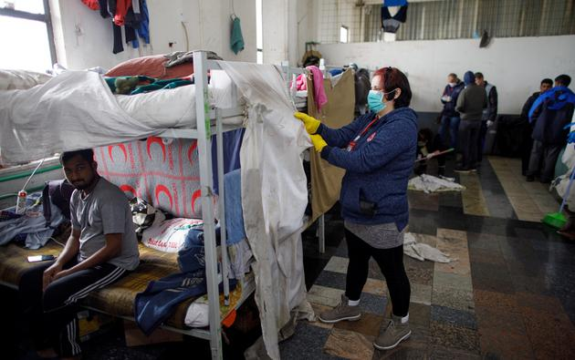 A woman is seen cleaning in refugee camp Miral in Velika Kladusa