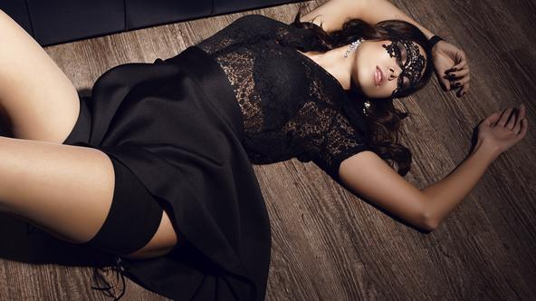 sexy woman with lace mask on the face lying on the floor