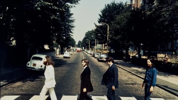 'The Beatles are seen walking across a zebra crossing in Abbey Road in London in this photograph taken in 1969 and received in London on May 18, 2012. The photograph, which will be auctioned by Blooms