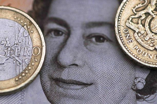 File photo illustration of a two Euro coin pictured next to a one Pound coin on top of a portrait of Britain's Queen ElizabethA two Euro coin is pictured next to a one Pound coin on top of a portrait of Britain's Queen Elizabeth in this file photo illustr