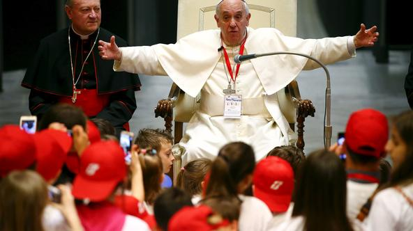 Pope Francis reacts during a special audience with members of the