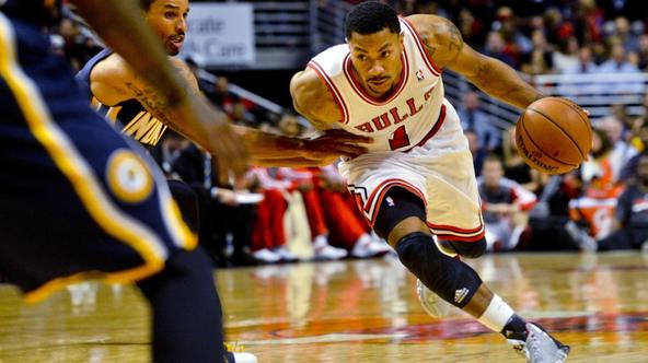'Oct 18, 2013; Chicago, IL, USA; Chicago Bulls guard Derrick Rose dribbles against the Indiana Pacers guard George Hill at the United Center. Mandatory Credit: Matt Marton-USA TODAY Sports'
