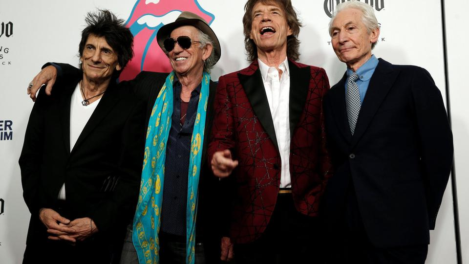 The Rolling Stones pose as they arrive for the opening of the new exhibit