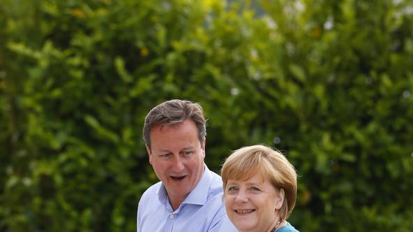 'Britain\'s Prime Minister David Cameron (L) welcomes Germany\'s Chancellor Angela Merkel to the Lough Erne golf resort where the G8 summit is taking place in Enniskillen, Northern Ireland June 17, 20