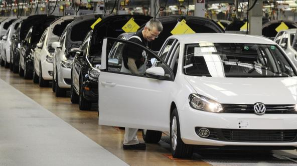 'Employees of German car manufacturer Volkswagen (VW) check VW Golf cars on March 8, 2010 at the main plant in Wolfsburg, northern Germany. Volkswagen holds its annual results 2009 press conference on