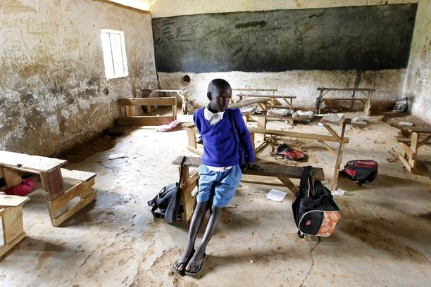 Seven-year-old Barack Obama Okoth, named after U.S. President Barack Obama, sits inside an empty classroom as he speaks with Reuters at the Senator Obama primary school in Nyangoma village in Kogelo, west of Kenya's capital Nairobi, June 23, 2015. When Ba