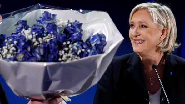 Marine Le Pen, French National Front (FN) political party leader and candidate for French 2017 presidential election, holds a bouquet of flowers as she celebrates after early results in the first round of 2017 French presidential election, in Henin-Beaumo