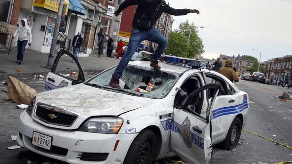ATTENTION EDITORS - REUTERS PICTURE HIGHLIGHT  Demonstrators jump on a damaged Baltimore police department vehicle during clashes in Baltimore, Maryland April 27, 2015.  REUTERS/Shannon Stapleton      TPX IMAGES OF THE DAY  REUTERS NEWS PICTURES HAS NOW M