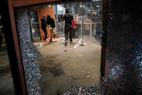 People loot property during nationwide unrest following the death in Minneapolis police custody of George Floyd, in Los Angeles