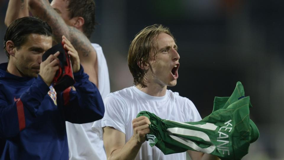 'Croatian midfielder Luka Modric celebrates at the end of the Euro 2012 championships football match Republic of Ireland vs Croatia on June 10, 2012 at the Municipal Stadium in Poznan. Croatia won 3 t