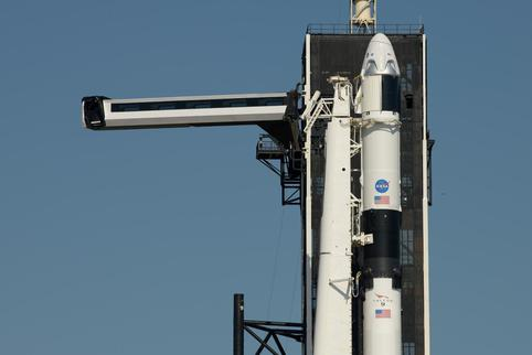 FILE PHOTO: The crew access arm is swung into position to a SpaceX Falcon 9 rocket with the company's Crew Dragon spacecraft onboard