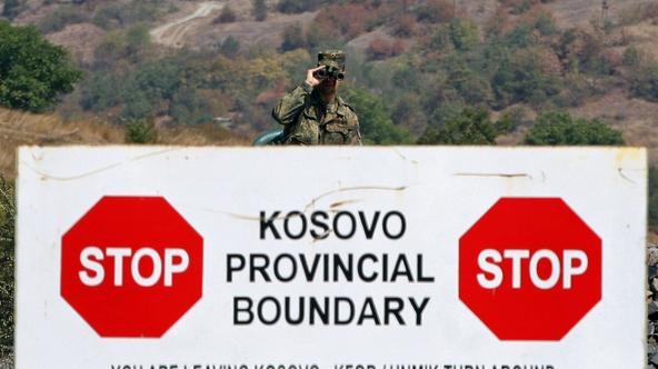 'A German KFOR soldier stands guard at the Jarinje border crossing between Serbia and Kosovo, on September 17, 2011. KFOR forces and Kosovo and European Union police and customs officers took control