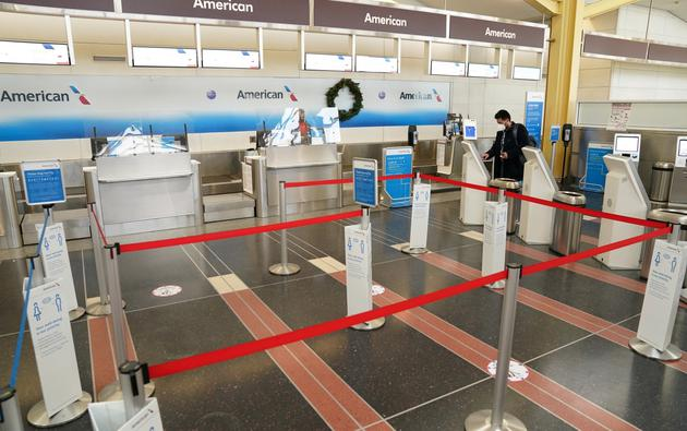 A holiday-week traveler checks in for his flight from Ronald Reagan Washington National Airport in Arlington, Virginia