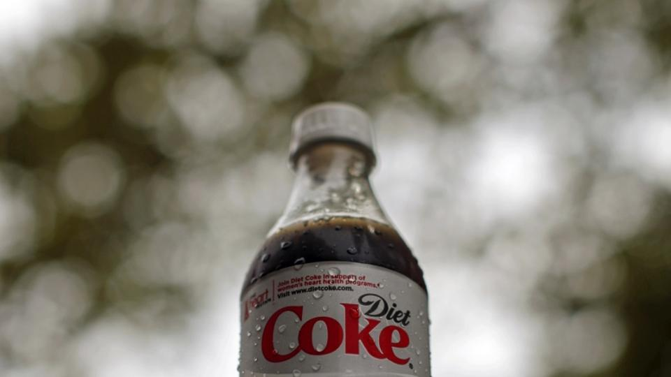 'A bottle of Diet Coke soft drink is seen in Arlington, Virginia, August 17, 2009. Coca-Cola Co's shares are set to rise as much as 20 percent, Barron's said in its August 17 edition, pointing to th