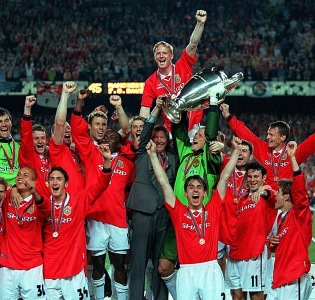 FILE PHOTO: Manchester United's players celebrate with the European Cup following their dramatic 2-1 victory over Bayern Munich in the final at Camp Nou in Barcelona, Spain.