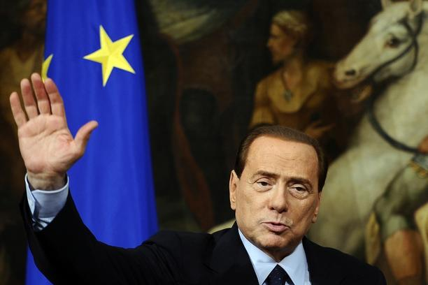 'Italian Prime Minister Silvio Berlusconi waves during a joint press conference with European Union commission President Jose Manuel Barroso (not pictured) following their meeting on March 14, 2011 at