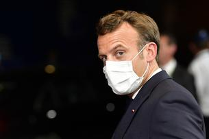 French President Emmanuel Macron leaves after a meeting of an EU summit on a coronavirus recovery package at the European Council building in Brussels