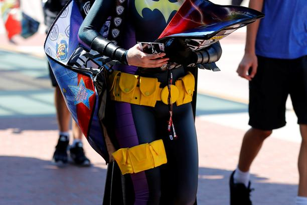 An attendee dressed as Bat Girl arrives for the start of Comic-Con International in San Diego, California, United States, July 20, 2016. REUTERS/Mike Blake