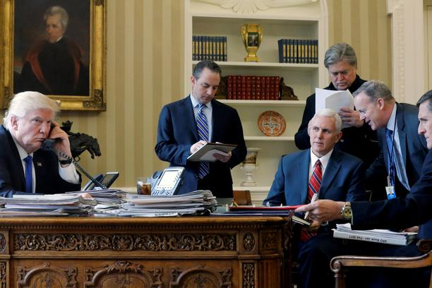 U.S. President Donald Trump (L-R), joined by Chief of Staff Reince Priebus, Vice President Mike Pence, senior advisor Steve Bannon, Communications Director Sean Spicer and National Security Advisor Michael Flynn, speaks by phone with Russia's President Vl