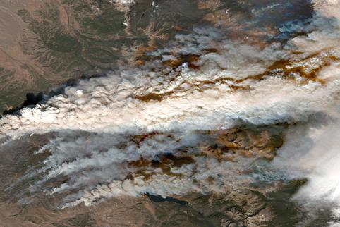 A satellite image shows an overview of the East Troublesome Fire at Grand Lake