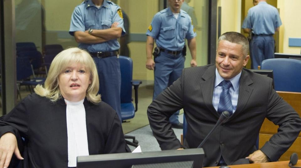 'Bosnian Muslim Naser Oric (R) and his lawyer Vasvija Vidovic sit in the courtroom of the International Criminal Tribunal for the former Yugoslavia (ICTY) as he waits for the judgement on his appeal i