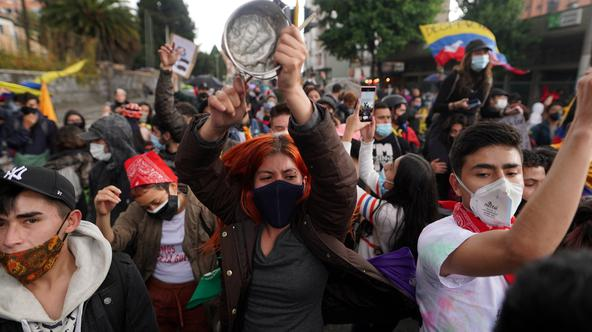 Demonstrators take to the streets to protest against poverty and police violence, in Bogota