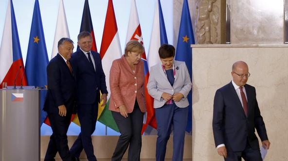Slovakia's Prime Minister Robert Fico (L to R), German Chancellor Angela Merkel, Poland's Prime Minister Beata Szydlo, Hungary's Prime Minister Viktor Orban and Czech Republic's Prime Minister Bohuslav Sobotka leave the news conference in Warsaw, Poland,
