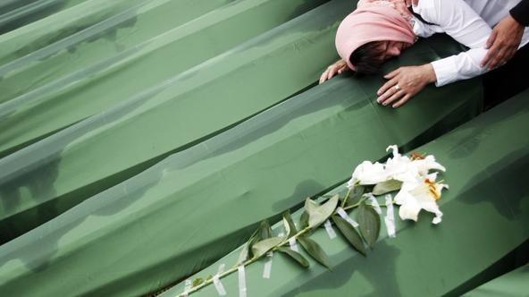 'A Bosnian woman cries on the coffin of a relative, which is one of the 409 coffins of newly identified victims from the 1995 Srebrenica massacre, in Potocari Memorial Center, near Srebrenica July 11,
