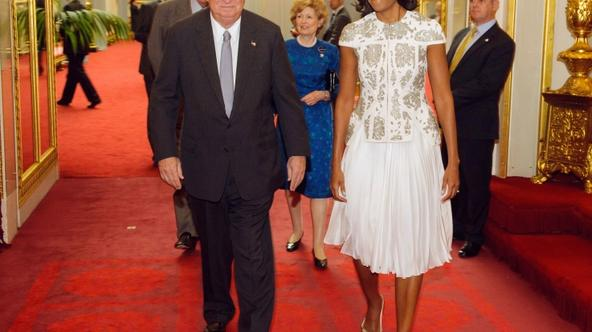 'US First Lady Michelle Obama (R) and US ambassador in Great Britain Louis Susman arrive at a reception at the Buckingham Palace, in London, on July 27, 2012 to welcome Heads of State and Heads of Gov