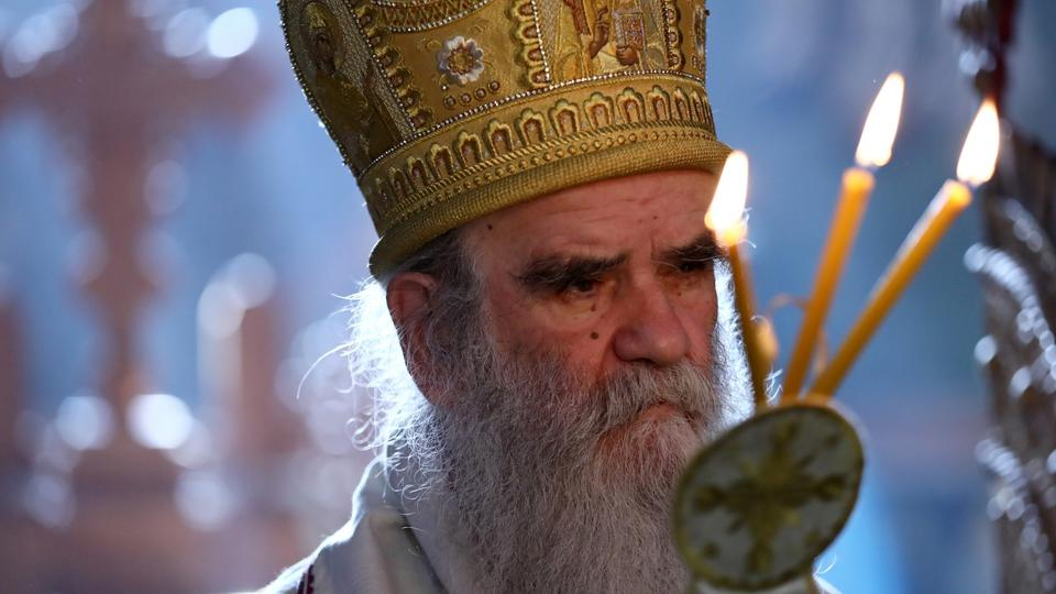 Metropolitan Amfilohije, the church's top cleric in Montenegro prays in Serbian Orthodox Moraca Monastery