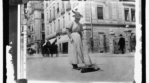 A woman street worker sweeps a street in Germany, circa 1909-1920, in this Library of Congress handout photo. For women 100 years ago, opportunities to work beyond the home and take part in political life were very limited. As the 20th century progressed,