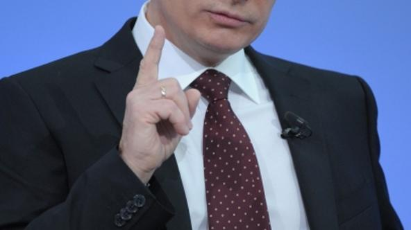 'Russia\'s Prime Minister Vladimir Putin gestures during his annual phone-in session with Russians in Moscow, on December 15, 2011. The carefully stage-managed annual phone-in, which allows Putin to f