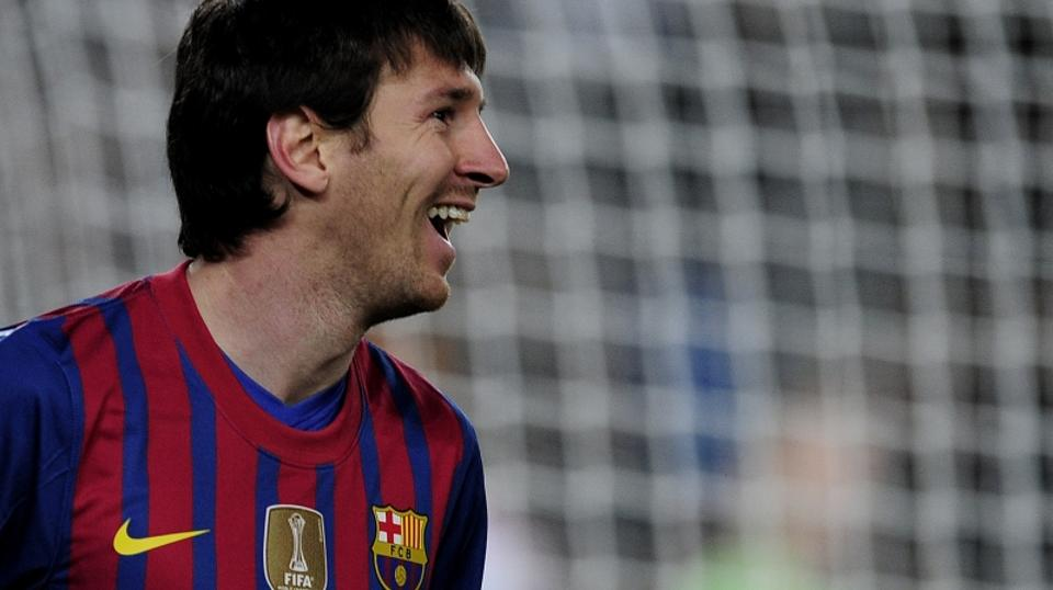 'Barcelona\'s Argentinian forward Lionel Messi celebrates a goal during the Champions League round of sixteen second leg football match between FC Barcelona vs Bayer 04 Leverkusen on March 7, 2012 at