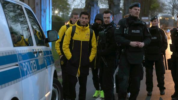 Borussia Dortmund players in a street in Dortmund, Germany, 11 April 2017. Three explosive devices detonated near the team bus shortly after its departure from the hotel in which the team was staying according to a statement by police in the city. The bus