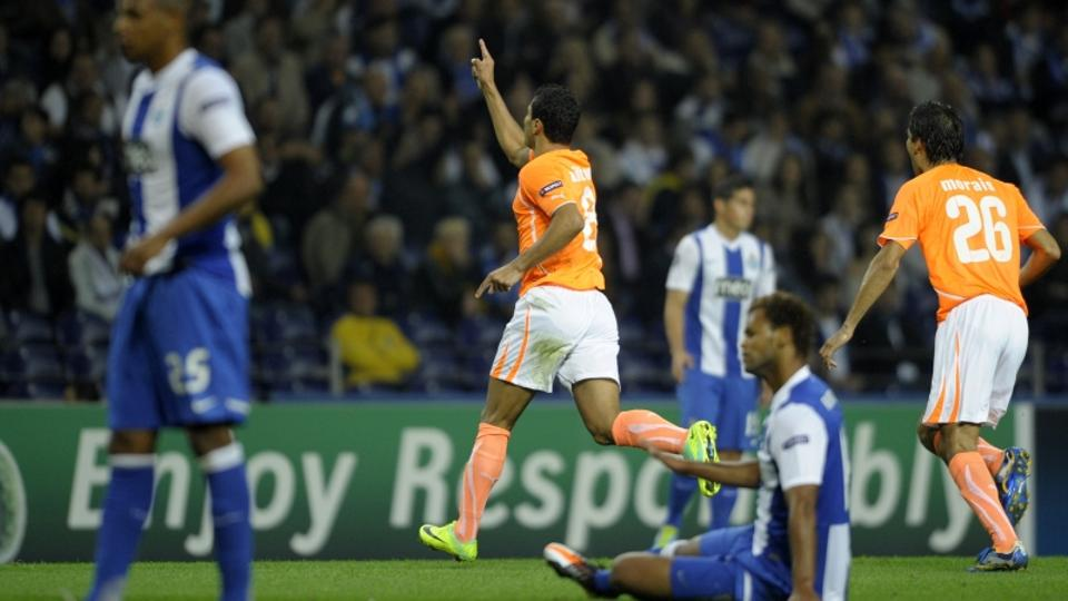 \'Apoel\'s Brazilian forward Ailton (C) celebrates after scoring against FC Porto during their UEFA Champions League, Group G, football match at the Dragao Stadium in Porto on October 19, 2011.  AFP P
