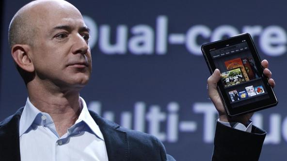 'Amazon CEO Jeff Bezos holds up the new Kindle Fire at a news conference during the launch of Amazon's new tablets in New York, September 28, 2011. REUTERS/Shannon Stapleton (UNITED STATES - Tags: BU