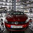 New Volkswagen models Golf Cabriolet and Passat are stored at the 'CarTowers' in the theme park 'Autostadt' next to the Volkswagen plant in Wolfsburg March 9, 2011. Volkswagen unveiled plans to cut 23,000 jobs in Germany to help achieve 3.7 billion euros