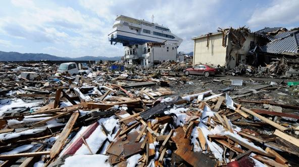 \'A cruise ship lies on the roof of a two storey building in Otsuchi, Iwate Prefecture, on March 24, 2011, after the recent earthquake and tsunami disaster.   Three workers at Japan\'s stricken Fukush