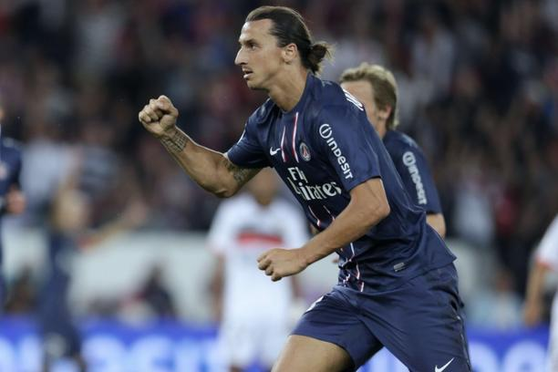 'Paris Saint-Germain\'s Swedish forward Zlatan Ibrahimovic celebrates after scoring a goal during the French L1 football match Paris (PSG) vs Lorient (FCL), on August 11, 2012 at the Parc des Princes