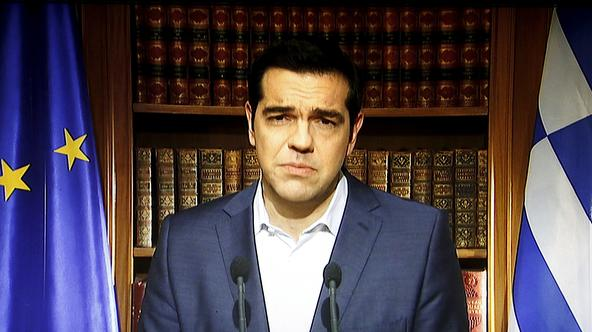Greek Prime Minister Alexis Tsipras is seen on a television monitor while addressing the nation in Athens, Greece July 1, 2015. Tsipras called on Greeks to vote 'no' in Sunday's referendum on a bailout package offered by creditors, in a defiant address th