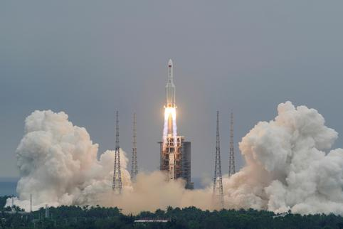 FILE PHOTO: Long March-5B Y2 rocket, carrying the core module of China's space station Tianhe, takes off from Wenchang